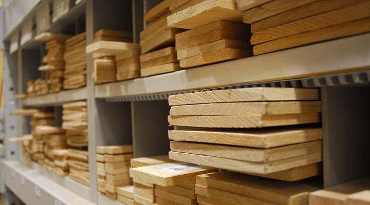 lumber boards on metal shelves