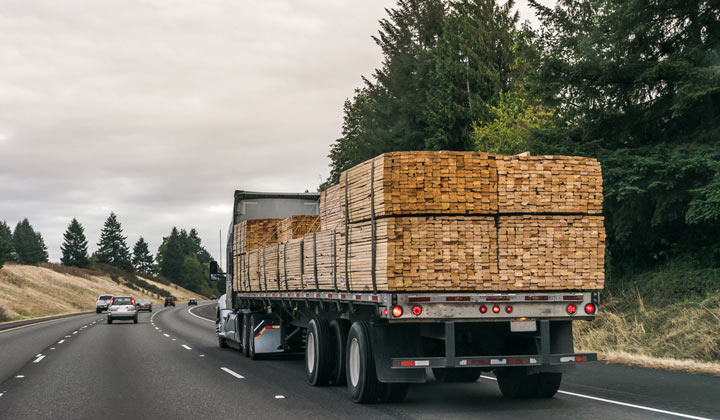 stacks of wooden boards on truck for delivery